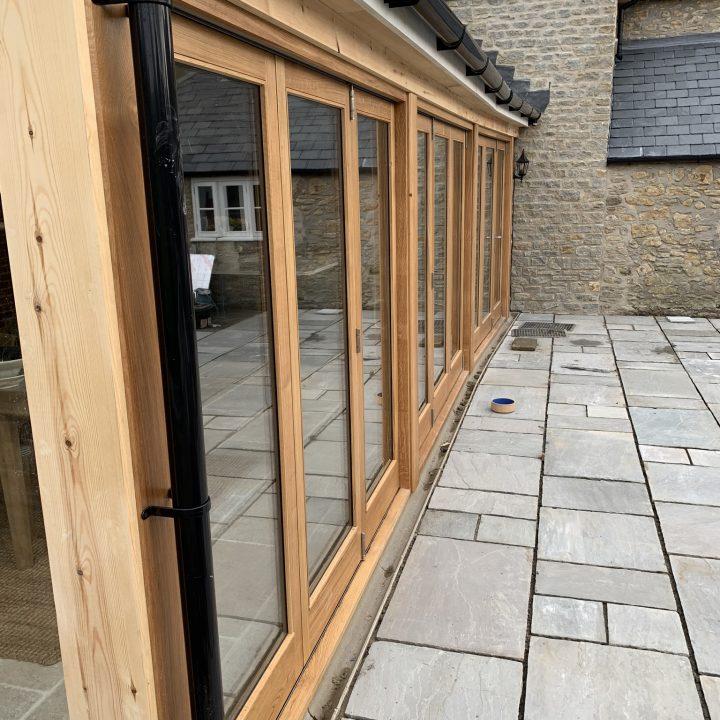Oak bi-folding doors – Burton Bradstock